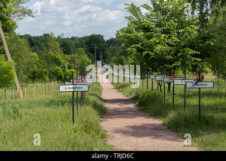 Signs with names of abandoned villages at the monument to the Chernobyl nuclear disaster , Chernobyl Exclusion Zone in Ukraine - Stock Photo