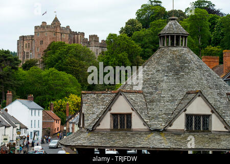 Dunster Exmoor Somerset England UK. May 2019 Showing Dinster Castle and Yarn Market Dunster is a village, civil parish and former manor within the Eng - Stock Photo