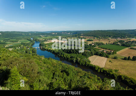 View from Domme looking down the Dordogne valley towards La Roque-Gageac, Castelnaud-la-Chapelle and the Jardins de Marqueyssac on a summer day - Stock Photo
