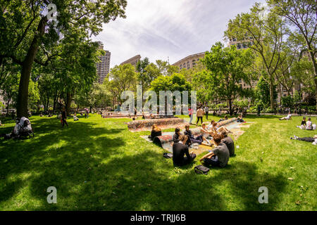 Visitors to Madison Square Park enjoy the warm weather by