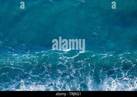 Blue sea texture with waves and foam. View from above. - Stock Photo
