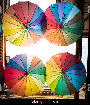 Colorful umbrellas in the sky of the Victoria Passage, in Bucharest city centre, Romania