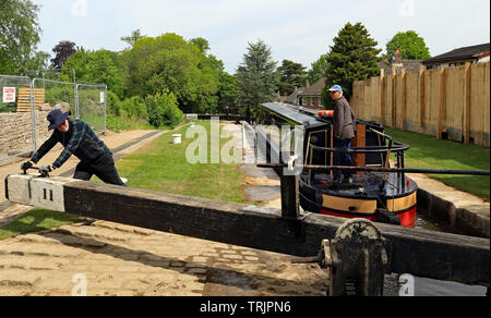 "The narrow boat ""Amy"" is starting to descend down lock 11 on the Marple flight of locks after the canal was reopened following extensive repairs. - Stock Photo"