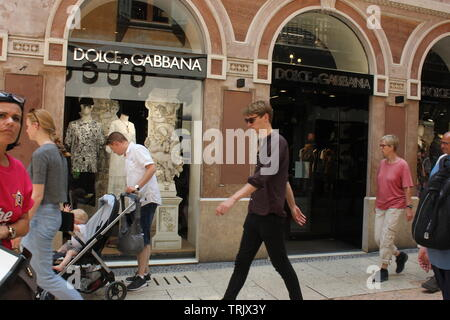 Luxury shopping street Via Mazzini in Verona with Dolce & Gabbana Store in the background. - Stock Photo