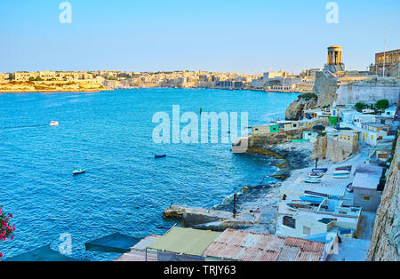 The small fishing village  faces Grand Harbour, it located at the fortress wall of Valletta, Malta - Stock Photo