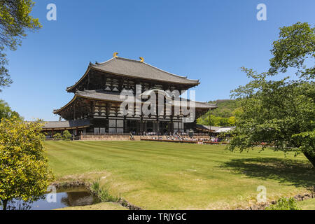 Todai-ji (Great Eastern Temple) is the buddhist temple in Nara, Japan, is the largest wooden buildingin the world. The complex has a hall wil a large - Stock Photo