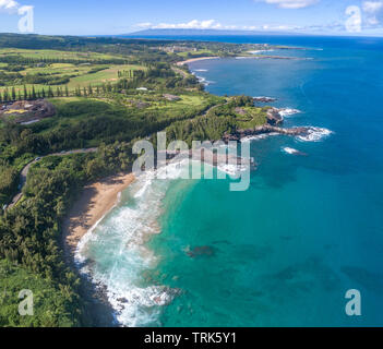 An aerial view of Slaughterhouse Beach looking back toward Kapalua with the island of Lanai on the horizon, Maui, Hawaii, USA. - Stock Photo