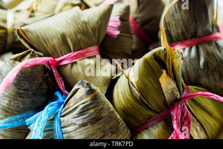 Close-up view of steamed Asian rice dumplings (Zongzi), a traditional food eaten during Dragon Boat Festival - Stock Photo