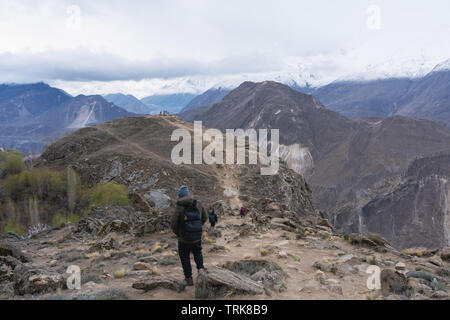 Group of people hiking on the mountain in Hunza valley, Pakistan. Travel lifestyle and adventurous concept - Stock Photo