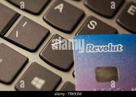 Bucharest, Romania - May 14, 2019: Macro image with the details of a Revolut plastic credit card, with the Revolut logo, on a laptop keyboard - online - Stock Photo
