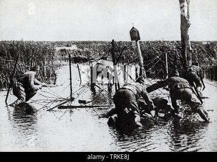 This photo dates to the First World War. The caption reads: Americans cutting wire entaglements prior to a drive. - Stock Photo