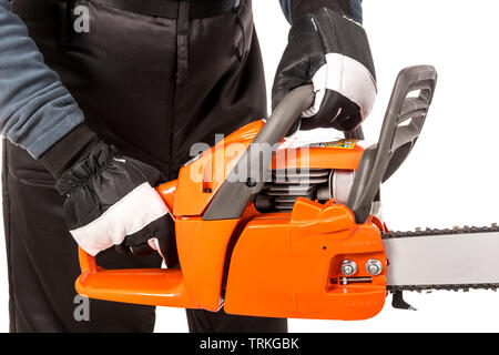 Hands showing how to hold a chainsaw safely - Stock Photo