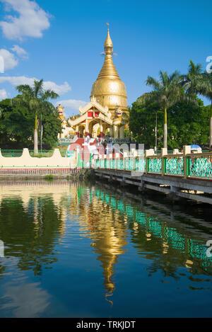 View of the Buddhist temple of the Maha Wizaya Pagoda on a sunny day. Yangon, Myanmar (Burma) - Stock Photo