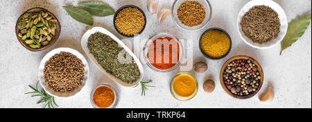 Various Spices on white background. Assortment, set of spices and condiments with vintage pepper mill, top view, banner. - Stock Photo