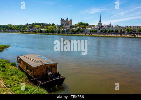 Chateau de Saumur and church Saint Pierre on river Loire, Maine et Loire, Pays de la Loire, France - Stock Photo