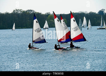 Sailing is a popular pastime on the Norfolk Broads with dinghies of various types taking part in racing and sail training on Wroxham Broad. - Stock Photo