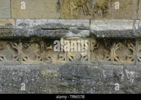 Chamfered plinth with quatrefoil band at the base of the tower of St Augustine's Church, Skirlaugh, East Yorkshire, England - Stock Photo
