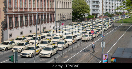 Taxi drivers demonstrate on the street - Stock Photo