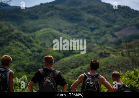 caucasian tourists hiking in the Guatemalan countryside - Stock Photo