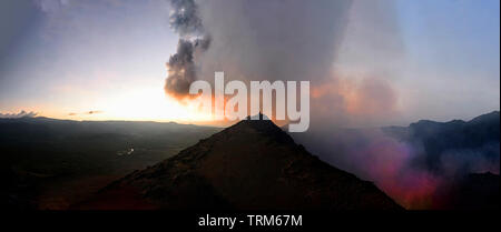 Glowing Lava, fumaroles, hot gases  and sparks at erupting Mt Yasur Volcano at sunset, Tanna Island, Vanuatu - Stock Photo