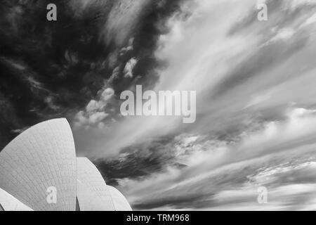 Beautiful black and white view of a dramatic sky above the city center of Sydney, Australia - Stock Photo