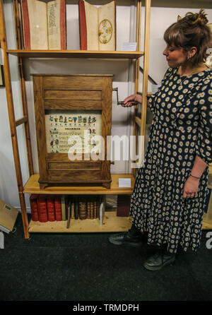 London, UK. 09th June, 2019.  The London's First Rare Book Fair, Benjamin Spaceman rare books offering one of the few known Rudiment Box in the world, originally owned by Darton and Sons from London .circa 1840.The Darton Rudiment Box was an educational tool for children in schools and nursery, its use was recorded in schools in England and Ireland from 1830's onwards. The basic design consisted of prints pasted on linen or paper and attached to two rollers. Credit: Paul Quezada-Neiman/Alamy Live News - Stock Photo