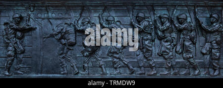 WW II Memorial. One of twenty four bronze bas-relief panel depicting scenes and events of the war effort. National Mall Washington DC - Stock Photo
