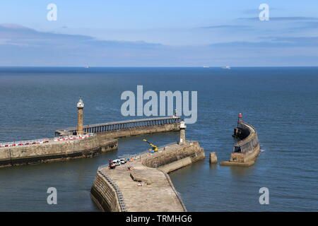 West and East Piers from St Mary's churchyard, Whitby, Borough of Scarborough, North Yorkshire, England, Great Britain, United Kingdom, UK, Europe - Stock Photo