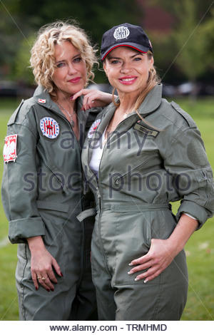 Two beautiful women in traditional polish pilot uniforms during Polish Heritage Day. - Stock Photo