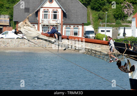 Sonderborg, Denmark - June 5, 2019: Two teenagers climb in the bowsprit net of the cruise ship Pegasus - Stock Photo