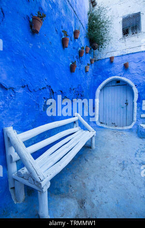 Flower pots in the blue city of Chefchaouen, Morocco - Stock Photo