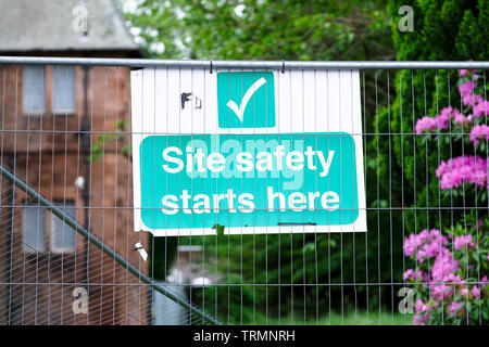 Site safety starts here sign at construction site - Stock Photo