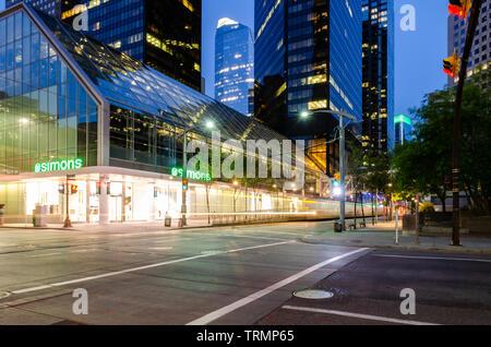 Long exposure of a Train on 7th Avenue outside the La Maison Simons store in Calgary, Alberta, Canada - Stock Photo