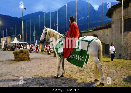 Primaluna/Italy - June 21, 2014: Medieval knight character ready for rings competition during the Medieval festival of six fractions of the town. - Stock Photo