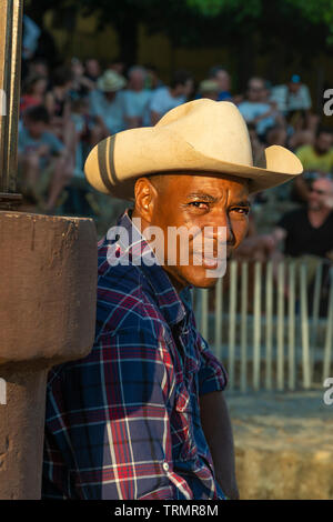 Cuban man wearing stetson in the old colonial town of Trinidad, Sancti Spiritus Province, Cuba, Caribbean - Stock Photo