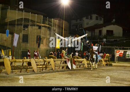 Primaluna/Italy - June 21, 2014: Medieval knight character competing during rings competition of the traditional village Medieval festival of the town - Stock Photo