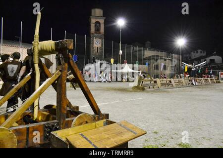 Primaluna/Italy - June 21, 2014: Medieval catapult wooden engine exposed during the traditional village festival of six fractions of the town. - Stock Photo