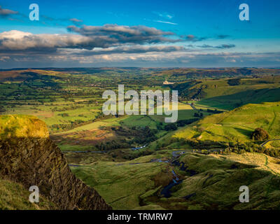 View from summit of Mam Tor down towards Castleton and Hope Valley with Breedon Hope Cement Works in distance, Peak District, UK. - Stock Photo