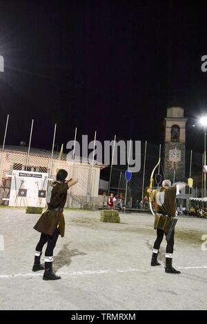Primaluna/Italy - June 21, 2014: Medieval archer competition during the traditional village festival of six fractions of the town. - Stock Photo