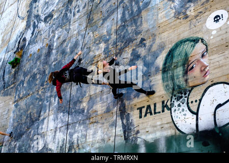 Abseiling dancers practising on the walls at Listening Station, Field Station Berlin at Teufelsberg, Germany - Stock Photo