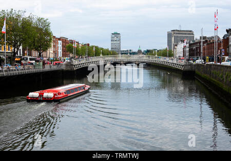 A tourboat on the River Liffey in Dublin, Ireland - Stock Photo