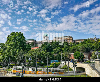 Buda Castle with yellow tram on a sunny day. Budapest - Hungary - Stock Photo