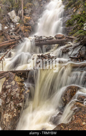 Spring thaw makes Fern Falls a churning torrent on Fern Creek in Rocky Mountain National Park, Colorado - Stock Photo