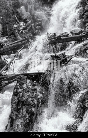 Spring thaw makes Fern Falls a raging torrent on Fern Creek in Rocky Mountain National Park, Colorado - Stock Photo