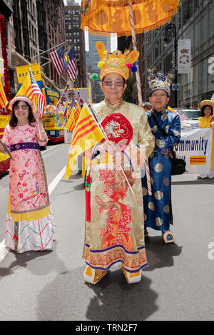 Portrait of an older man in traditional ethnic clothing & shoes at the Vietnamese American Cultural Parade in Midtown Manhattan, New York City. - Stock Photo
