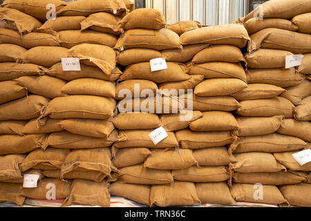 warehouse of Cafe La Viet, Da Lat City, Lam Dong Province, Vietnam - May 21, 2019: Sacks filled with carefully selected coffee of La Viet Coffee in Da - Stock Photo