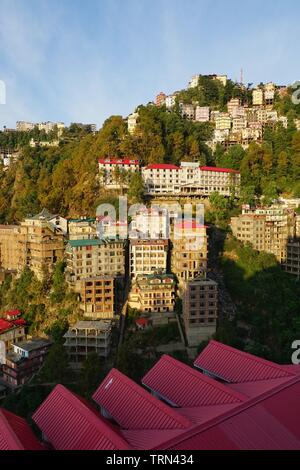 Morning Sun illuminating Hillside Houses in a Residential District - Stock Photo