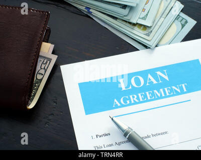 Loan agreement application and pen for filling in. - Stock Photo
