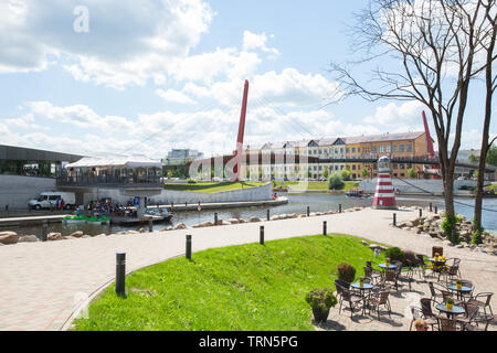 City Jelgava, Latvian Republic. River Lielupe, peoples and urban city view. Houses and walking paths. Jun 9. 2019. Travel photo. - Stock Photo