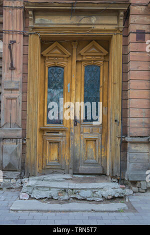 City Jelgava, Latvian Republic. Old wooden doors, house exterior. Jun 9. 2019. Travel photo. - Stock Photo